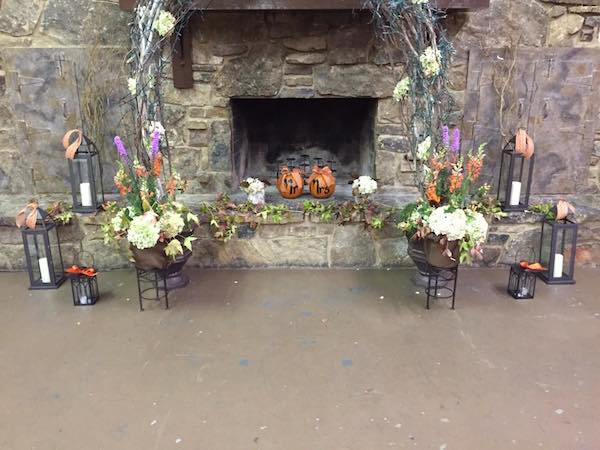 orange fall wedding flowers by kacie cooper floral designer backdrop