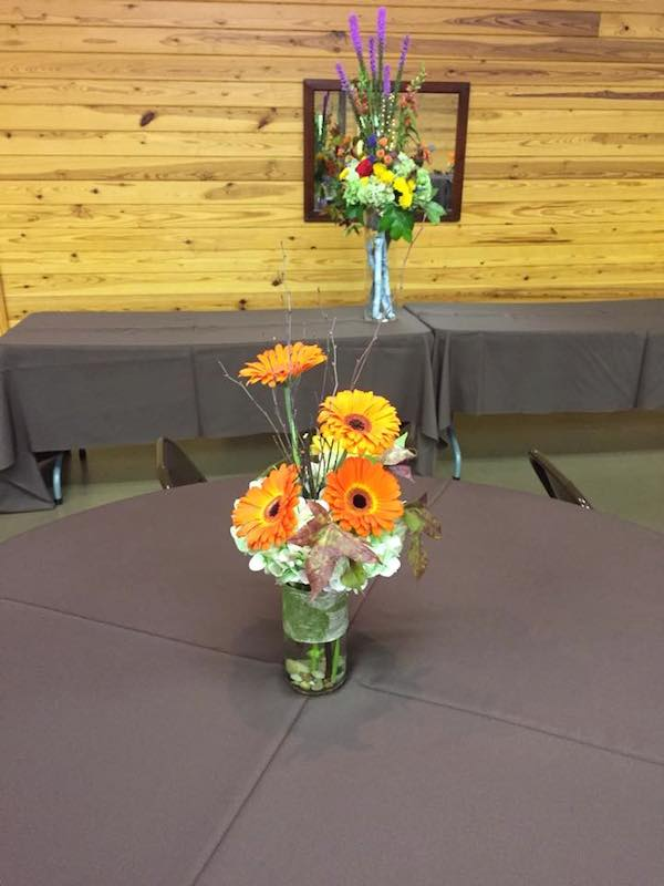 orange fall wedding flowers by kacie cooper floral designer tables