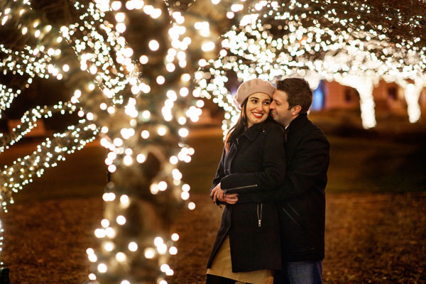 christmas card engagement photos with christmas lights
