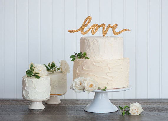 gold love wedding cake topper - gold wedding inspiration