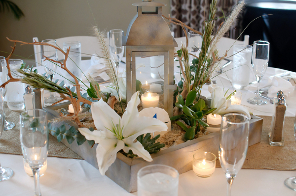 beach lantern wedding centerpiece - photo by Carrie Wildes Photography - midsouthbride.com