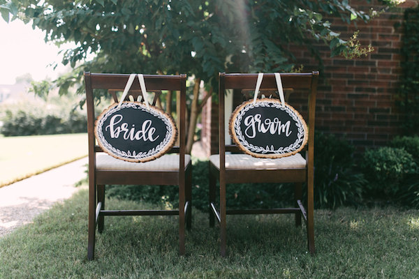 bride and groom stump signs for wedding chairs - by Kelly Ginn